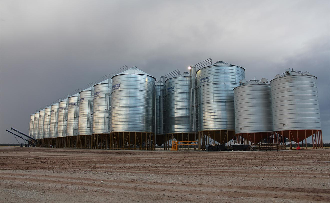 Farm with grain silos on an overcast day